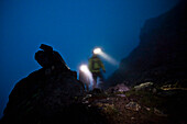 Mountaineers with headlamps on southeast ridge of Wildspitze, Oetztal Alps, Tyrol, Austria