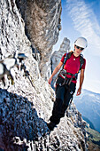 Female mountaineer at Findenegg way, Montasch, Julian Alps, Friuli-Venezia Giulia, Italy