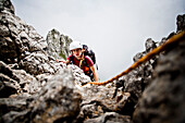 Female mountaineer at Kopftoerlgrat, Ellmauer Halt, Kaiser Mountain Range, Tyrol, Austria