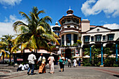 People in front of the Le Caudan Waterfront shopping center, Port Louis, Mauritius, Africa