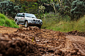Off-road vehicle on muddy road, Tour to Dimitile mountain, La Reunion, Indian Ocean