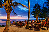 People in a beach bar in the evening, Saint Gilles, La Reunion, Indian Ocean
