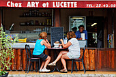 People at a bistro in Petite-Ile, La Reunion, Indian Ocean