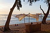 Beach chair on the beach of Grand Hotel du Lagoon at sunset, Saint Gilles, La Reunion, Indian Ocean