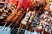 Fish skewers at a stand at the night market, Forodhani Gardens, Stonetown, Zanzibar City, Zanzibar, Tanzania, Africa