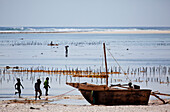Children and boat on the beach, Matemwe, Zanzibar, Tanzania, Africa