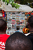 People in front of bookstall at Darajani Market, Stonetown, Zanzibar City, Zanzibar, Tanzania, Africa