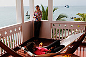 People on rooftop terrace of Serena Inn hotel, Stonetown, Zanzibar City, Zanzibar, Tanzania, Africa