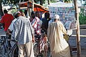 People in front of bookstall at Darajani Market, Stonetown, Zanzibar City, Zanzibar, Tanzania, Africa