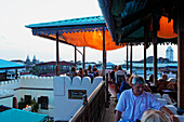People on the roof terrace of the Hurumzi hotel in the evening, Stonetown, Zanzibar City, Zanzibar, Tanzania, Africa