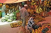 People at fruit stand at Darajani Market, Stonetown, Zanzibar City, Zanzibar, Tanzania, Africa