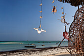 Deserted beach and boats at Nungwi village, Nungwi, Zanzibar, Tanzania, Africa