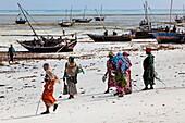 Local people on the beach at Nungwi village, Nungwi, Zanzibar, Tanzania, Africa