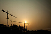 Silhouetted Construction Cranes, Beijing, China