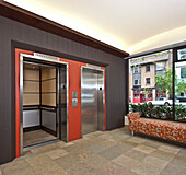 Stainless Steel Elevator Doors And A Bench Seat, Seattle, WA, USA