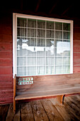 Wooden Bench on Rustic Porch, Pioneertown, California, USA