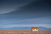 Remote House in Barren Lanscape, Alamosa, Colorado, USA