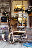 Old Wooden Rocking Chair on a Wooden Porch, Louisiana, USA