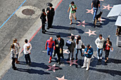 High angle view of people on Walk of Fame, Hollywood Boulevard, Hollywood, Los Angeles, California, USA, America