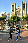 People at fountain in front of the Grace Cathedral, San Francisco, California, USA, America