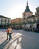 Tourists and townhall at Plaza Mayor, El Burgo de Osma, Castile and León, Spain