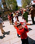 Kids carrying litter with cross, Cruzes de Mayo celebration, Baeza, Andalusia, Spain