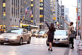 Women stopping taxis, Manhattan, New York City, United States of America, USA