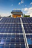 Solar installations and wind turbines on a roof, Freiburg im Breisgau, Baden-Wurttemberg, Germany