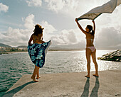 Women at the marine pool in Ribeira Grande, northern shore of Sao Miguel island, Azores, Portugal