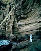 Pumice rock molded by erosion, cliff line at Porto de Pesca, Capelas, northern shore of Sao Miguel island, Azores, Portugal