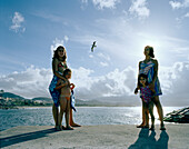 Women with kids at the marine pool in Ribeira Grande, northern shore of Sao Miguel island, Azores, Portugal
