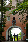 Entrance arch to the village of Portmeirion, founded by Welsh architekt Sir Clough Williams-Ellis in 1926, Wales, UK