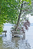 Bench in high flood, lake Starnberg, Bavaria, Germany