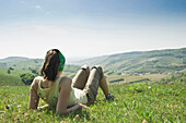 Woman resting on meadow, Kaiserstuhl, Baden-Wurttemberg, Germany