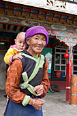 Old Tibetean farmer women with baby in Lhasa, Tibet Autonomous Region, People's Republic of China