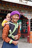 Old Tibetean farmer women with baby in Lhasa, Tibet Autonomous Region, People's Republic of China