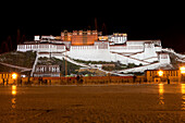 Potala Palace at night, residence and government seat of the Dalai Lamas in Lhasa, Tibet Autonomous Region, People's Republic of China