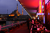 Restaurants on Galata bridge and Yeni Valide Camii mosque in the evening, Istanbul, Turkey, Europe