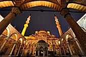 Illuminated Yeni Valide Mosque in the evening, Istanbul, Turkey