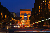 Champs-Elysees in the evening, Arc de Triomphe in background Paris, France