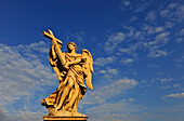 Angel with cross in the sunlight, Ponte Sant'Angelo, Rome, Lazio, Italy, Europe