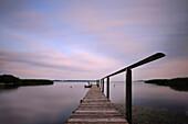Jetty at dusk, Neeberg, Achterwasser, Usedom, Mecklenburg-Western Pomerania, Germany