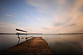 Bench on a jetty at dusk, Neeberg, Achterwasser, Usedom, Mecklenburg-Western Pomerania, Germany