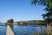 Wooden landing stages and boathouses at lake Klopeiner See, lake Klopeiner See, Carinthia, Austria, Europe