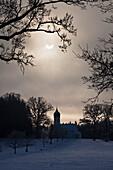 Partial solar eclipse (4th Jan 2011, 9:08 h), Hub chapel, Penzberg, Upper Bavaria, Germany