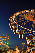 Illuminated ferris wheel at the Oktoberfest at night, Theresienwiese, Munich, Bavaria, Germany, Europe, Europe