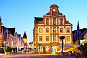 View to tower Altpoertel at the end of Maximilianstrasse, illuminated at dusk, Speyer, Rhineland-Palatinate, Germany