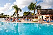 People relax by the swimming pool of Sol Cayo Coco Hotel, Cayo Coco (Jardines del Rey), Ciego de Avila, Cuba