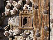 Detail of weathered wooden door, Door of the Apostles (14th century) of the church of Santa Maria la Mayor, Morella. Els Ports, Castellon province, Comunidad Valenciana, Spain