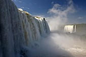 water flowing over iguazu falls brazilian side iguacu national park, parana, brazil, south america